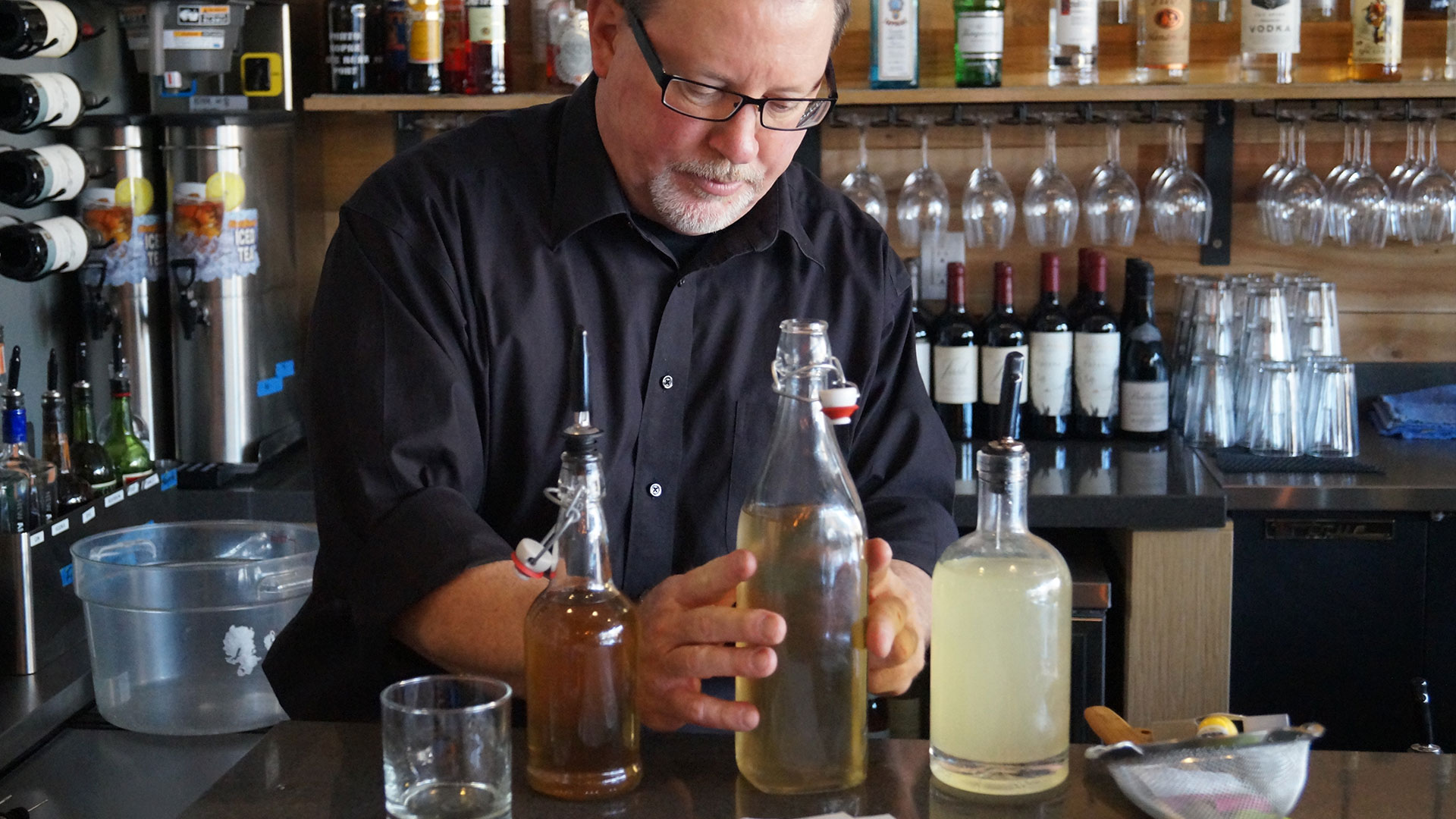bartender mixing cocktails at Piedmont Bistro by Venue in Lincoln, NE